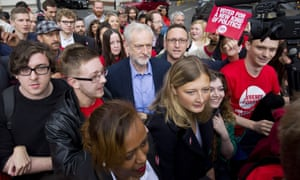 Party leadership candidate Jeremy Corbyn is mobbed by supporters as he arrives to attend the ballot result for the new Labour leader