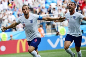 And England celebrate their second goal.