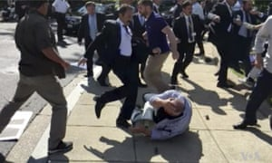 In this frame grab from video provided by Voice of America, members of President Recep Tayyip Erdoğan's security detail are shown violently reacting to peaceful protesters during his 2017 trip to Washington.