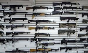 Semiautomatic rifles on a wall in a gun shop in Lynnwood, Washington on 7 November 2017.