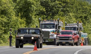 Military police direct traffic near the site where an armored personnel vehicle overturned, killing at least one person, in Cornwall, New York, on 6 June.