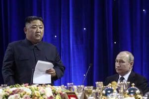 Putin listens intently to a speech by Kim
