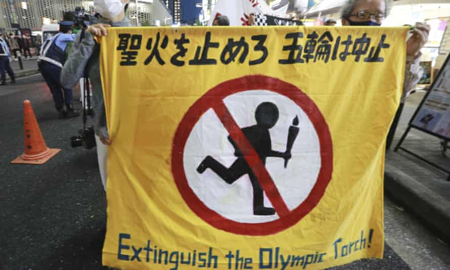 Protesters march in Tokyo last week to call for the cancellation of the Olympics.