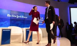 Sheryl Sandberg and New York Times journalist Andrew Ross Sorkin arrive at the World Economic Forum in Davos on 20 January 2016.