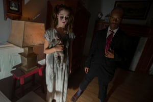 Actors depicting the legends of ghosts living inside New York's Dakota apartment building as part of Nightmare: New York, a haunted house for adults