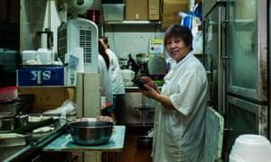 Zhang Zhenping, a dumpling stall owner originally from Tianjin, China, in her shop in Hong Kong.