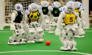 The robotic equivalent of Ronaldo lines up a free kick at a RoboCup football competition.