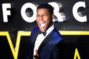 Looking happy to be in London John Boyega greets his fans