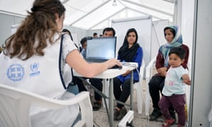 A family of refugees registers for asylum in Greece.