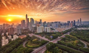 the sun sets over shenzhen china