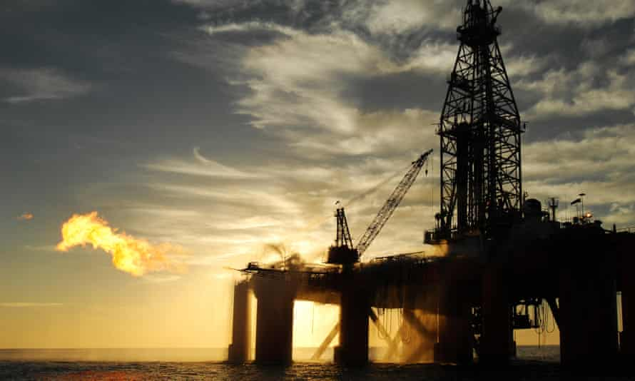 An oil rig in the ocean exploring for oil and gas.