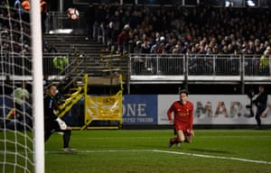 Plymouth keeper Luke McCormick, left, and Liverpool's Harry Wilson watch in horror/anticipation as the ball heads towards the goal.