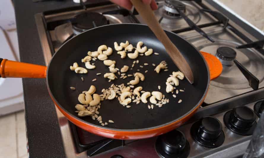 Heating cashews in a frying pan