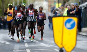 Ethiopia's Kenenisa Bekele, right, in action behind the pace setters during the men's race.