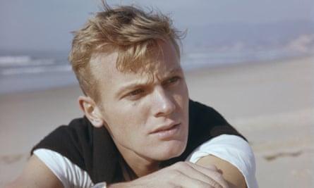 American actor Tab Hunter on a beach, circa 1955.