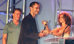 Gary Barlow watches as Louise presents the Brit award for international breakthrough act to Robert Miles in 1997.