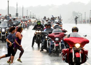Participants in the Rolling Thunder annual motorcycle rally, ride on Arlington Memorial Bridge under heavy rain in Washington DC