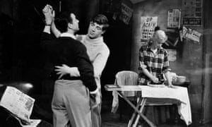 Jimmy Porter, played by Kenneth Haigh, dances with his friend Cliff (Alan Bates) while his wife Alison (Mary Ure) uses the offending ironing board in a scene from John Osborne's 1956 production of Look Back in Anger at the Royal Court Theatre in London.