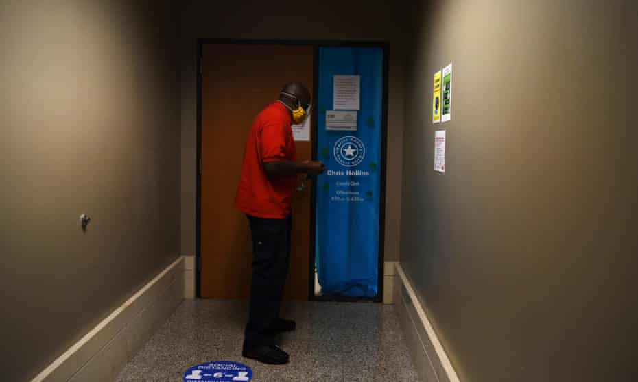 A Harris county employee walks inside the downtown Harris county clerk's office, which was banned from serving as a mail ballot drop-off site after Governor Greg Abbott issued an order limiting each Texas county to one mail ballot drop-off site, in Houston, Texas.