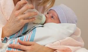 Mother feeding newborn in hospital