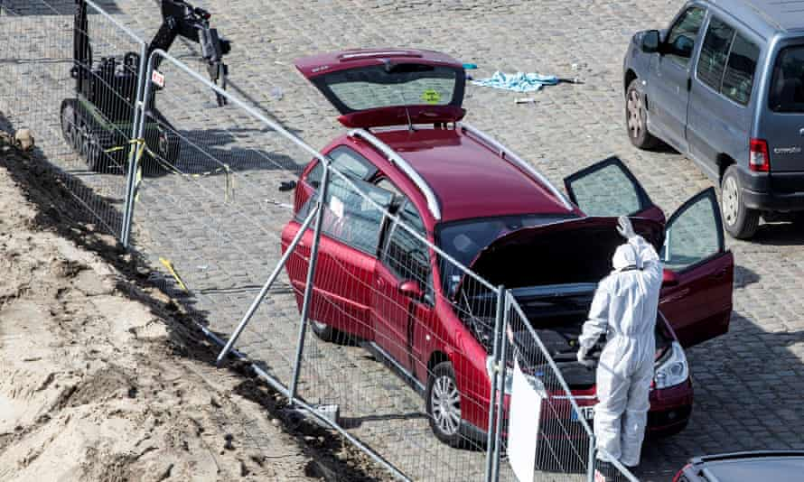 An investigator stands next to a car that had entered a pedestrian shopping street in Antwerp.