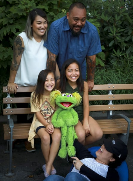 Jaana, standing left, and Sam Woodbury, from Irvine, California, and their daughters Salia, 10, seated right, and Kya, 6, with Karli and the puppeteer Haley Jenkins in New York.