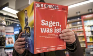 """Der Spiegel Addresses Reporting Scandal In New IssueCOLOGNE, GERMANY - DECEMBER 22: A man looks into the latest issue of German newsweekly Der Spiegel with a cover page that reads: """"To say, what is"""" at a kiosk on December 22, 2018 in Cologne, Germany. The quote refers to the credo of Rudolf Augstein, founder of the magazine, in his and the magazine's commitment to honest reporting. The issue is devoted to a scandal that has rocked Der Spiegel: the recent revelation by the magazine that one of its star reporters, Claas Relotius, fabricated large portions of at least a dozen stories he wrote. (Photo by Thomas Lohnes/Getty Images)"""