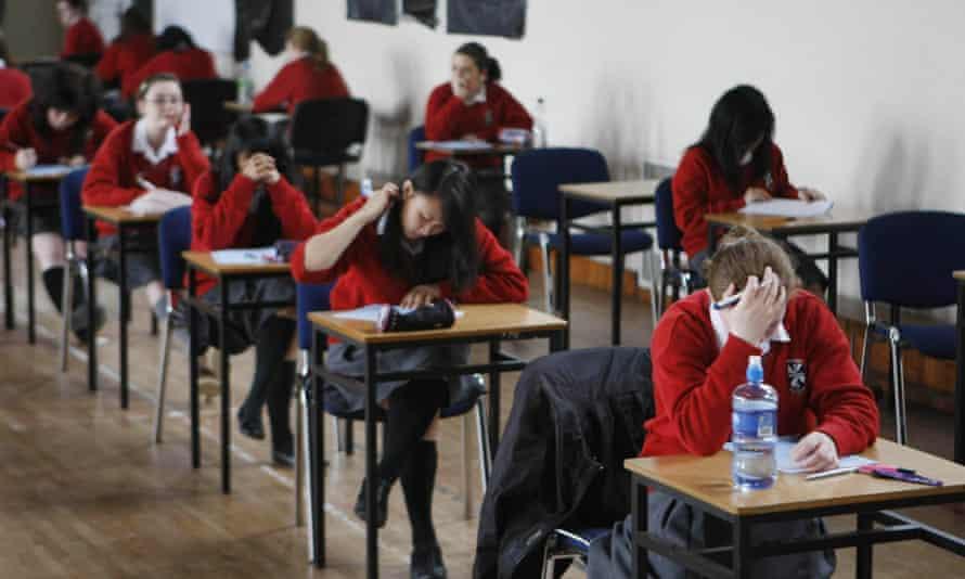 Students sitting at desks taking exam