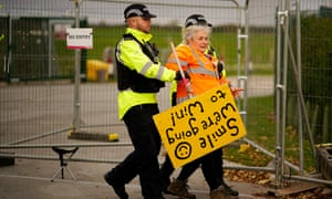 An anti-fracking protester is restrained on at the Preston New Road drill site in Lancashire.