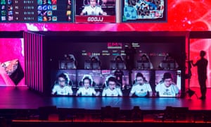 Team Hong Kong, Taiwan and Macau (C) play on stage in the League of Legends gaming tournament during the eSports and Music Festival in Hong Kong on August 4, 2017