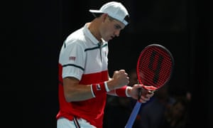 John Isner celebrates after scoring a point during his victory over Thiago Monteiro.