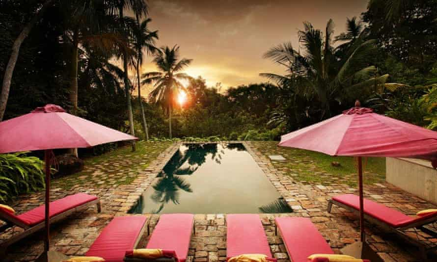 Sunset over the pool at Old Palm House, Sri Lanka