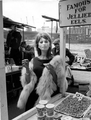 Sophia Loren enjoys the local cuisine while filming The Millionairess in