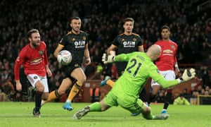Juan Mata deftly chips over the advancing Wolves goalkeeper John Ruddy to give Manchester United the lead at Old Trafford.