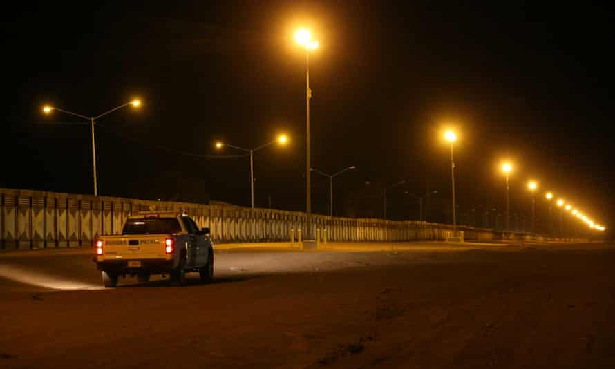 US border patrol agents monitor the barrier with Mexico at Calexico, California.