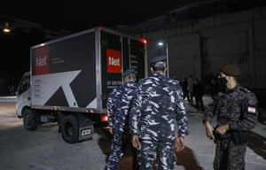 Members of Lebanese security forces stand next to a truck transporting boxes of the first shipment of the Covid-19 Pfizer-BioNTech vaccine upon arrival to the Rafic Hariri University Hospital in the capital Beirut, on 13 February, 2021.