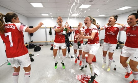 Arsenal's Katie McCabe and Louise Quinn celebrate after the match.