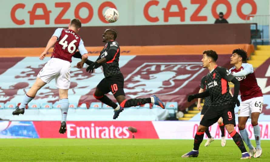 Sadio Mané leaps to score Liverpool's third goal.