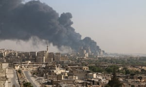 Smoke rises from a regime-controlled cement factory in Aleppo, Syria, 9 August.