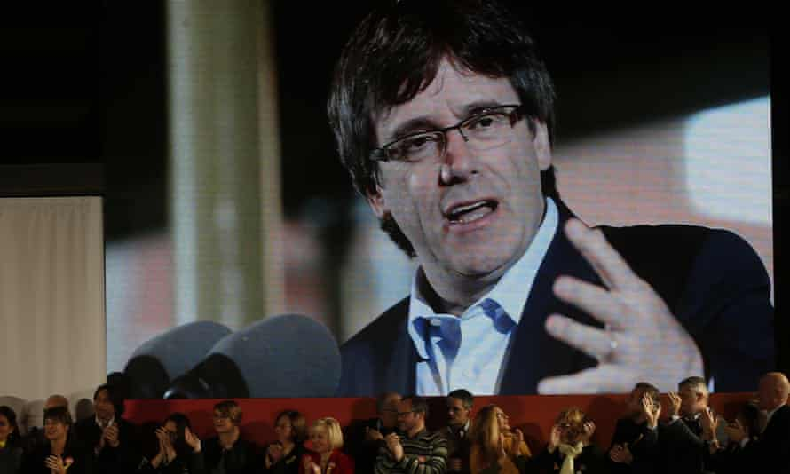 Ousted Catalan president Carles Puigdemont appears on a giant screen during an election event in Barcelona