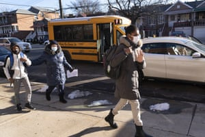 Students arrive at Meyer Levin Middle School, Thursday, on 25 February, 2021, in New York. In-school learning resumed for middle school students in New York City for the first time since the fall of 2020.
