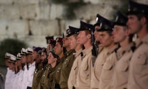 An honour guard of Israeli soldiers observe a minute's silence at the start of Remembrance Day.