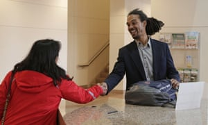 Braxton Winston, right, greets a Charlotte city staffer as he arrives for an orientation meeting at the government center last week.