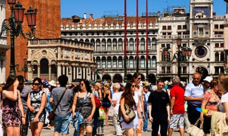 Tourists walking in the Piazza San Marco, VeniceTourists walking in the Piazza San Marco, also known as St. Mark's Square, in the UNESCO World Heritage Site of Venice.