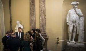 Senator Jeff Flake talks to reporters.
