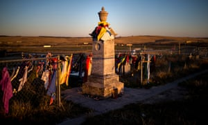 Peace offerings of tobacco ties line the fence at the Wounded Knee Memorial on Pine Ridge Reservation in South Dakota.