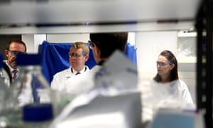 Jacinda Ardern, right, and Covid minister Chris Hipkins visit a lab at Auckland University.