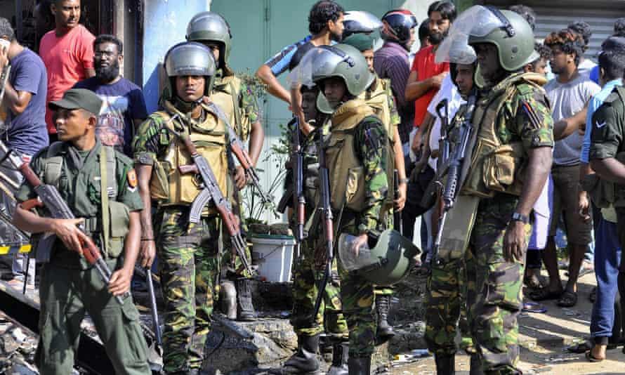 Sri Lankan troops patrol on the streets of Pallekele, a suburb of Kandy.
