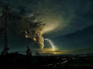 Lightning strikes over Batangas as the Taal volcano erupts