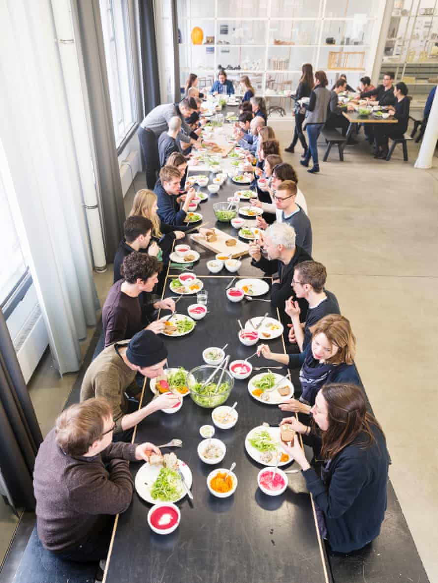 Olafur Eliasson (top of table) eating with staff at The Kitchen in his Berlin studio
